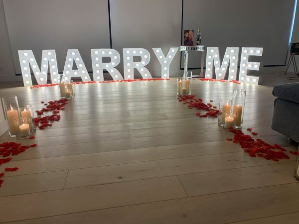hire marry me sign